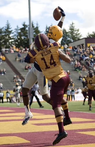 Sep 21, 2013; Mount Pleasant, MI, USA; Toledo Rockets wide receiver Alonzo Russell (9) makes a catch for a touchdown against Central Michigan Chippewas defensive back Jason Wilson (14) during the second quarter at Kelly/Shorts Stadium. Mandatory Credit: Raj Mehta-USA TODAY Sports