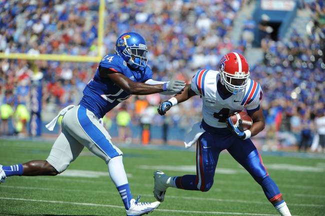 Sep 21, 2013; Lawrence, KS, USA; Louisiana Tech Bulldogs wide receiver Sterling Griffin (4) is pushed out of bounds by Kansas Jayhawks cornerback JaCorey Shepherd (24) in the first half at Memorial Stadium. Mandatory Credit: John Rieger-USA TODAY Sports