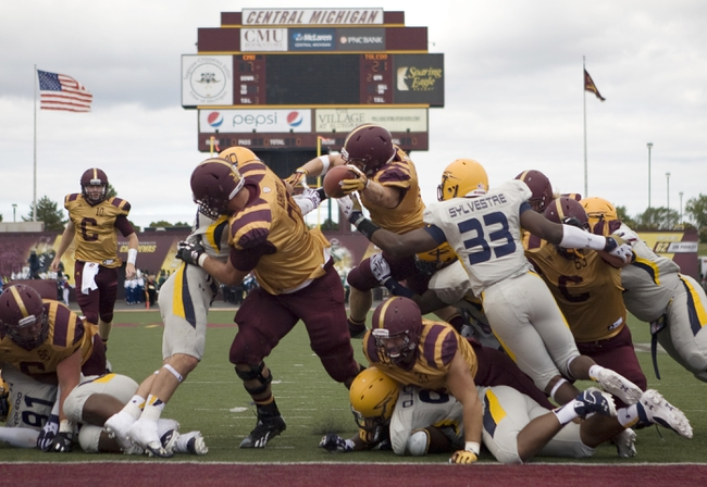 Sep 21, 2013; Mount Pleasant, MI, USA; Central Michigan Chippewas running back Saylor Lavallii (6) runs in for a touchdown against the Toledo Rockets during the second quarter at Kelly/Shorts Stadium. Mandatory Credit: Raj Mehta-USA TODAY Sports
