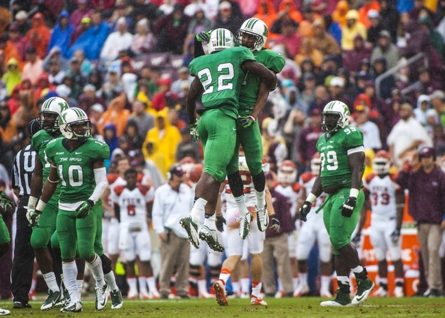 Sep 21, 2013; Blacksburg, VA, USA; Marshall Thundering Herd safety D.J. Hunter (22) and defensive back Derrick Thomas (2) celebrate a defensive stop against the Virginia Tech Hokies during the first half at Lane Stadium. Mandatory Credit: Peter Casey-USA TODAY Sports