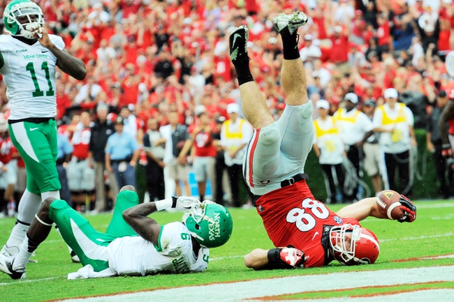Sep 21, 2013; Athens, GA, USA; Georgia Bulldogs tight end Arthur Lynch (88) scores a touchdown past North Texas Mean Green defensive back Hilbert Jackson (6) during the second quarter at Sanford Stadium. Mandatory Credit: Dale Zanine-USA TODAY Sports