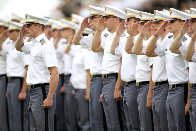 Sep 21, 2013; West Point, NY, USA;  West Point cadets from the first regiment of the Corps of Cadets salute during the national anthem before a game between Army and Wake Forest at Michie Stadium. Mandatory Credit: Danny Wild-USA TODAY Sports