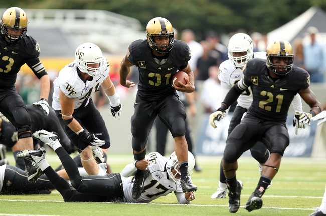 Sep 21, 2013; West Point, NY, USA;  Army Black Knights running back Terry Baggett (31) runs with the ball during the first half against the Wake Forest Demon Deacons at Michie Stadium. Mandatory Credit: Danny Wild-USA TODAY Sports