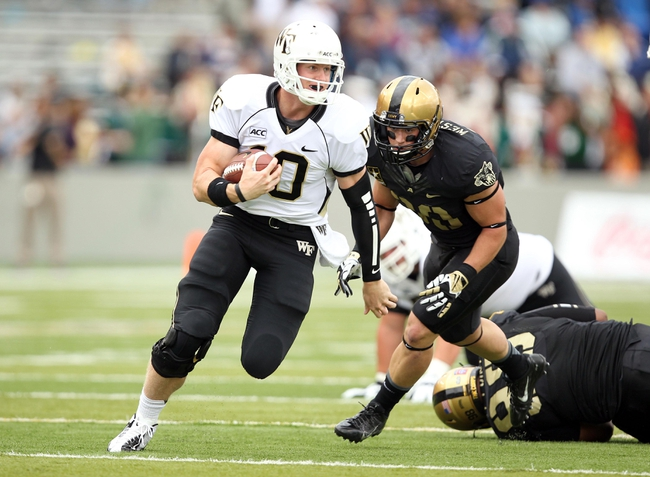 Sep 21, 2013; West Point, NY, USA;  Wake Forest Demon Deacons quarterback Tanner Price (10) runs the ball during the first half against the Army Black Knights at Michie Stadium. Mandatory Credit: Danny Wild-USA TODAY Sports