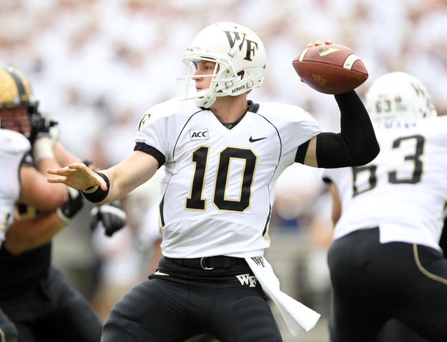 Sep 21, 2013; West Point, NY, USA;  Wake Forest Demon Deacons quarterback Tanner Price (10) looks to pass during the first half at Michie Stadium. Mandatory Credit: Danny Wild-USA TODAY Sports