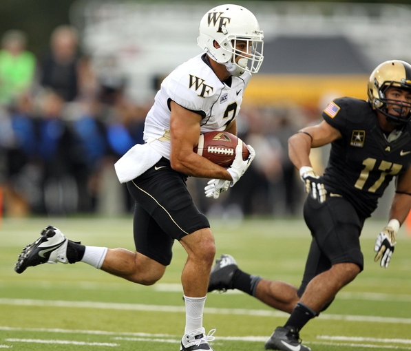 Sep 21, 2013; West Point, NY, USA; Wake Forest Demon Deacons wide receiver Michael Campanaro (3) runs for a touchdown during the first half against the Army Black Knights at Michie Stadium. Mandatory Credit: Danny Wild-USA TODAY Sports