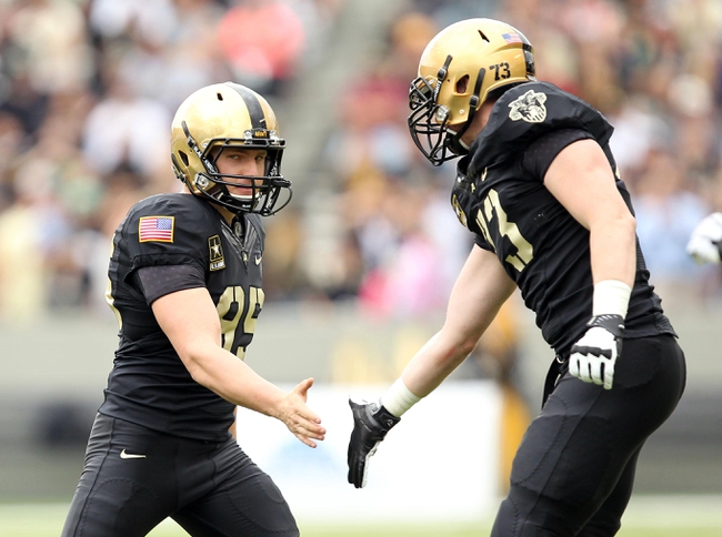Sep 21, 2013; West Point, NY, USA;  Army Black Knights kicker Daniel Grochowski (95) celebrates after hitting a field goal during the first half against the Wake Forest Demon Deacons at Michie Stadium. Mandatory Credit: Danny Wild-USA TODAY Sports