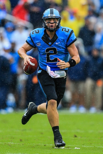 Sep 21, 2013; Atlanta, GA, USA; North Carolina Tar Heels quarterback Bryn Renner (2) runs before throwing a touchdown pass in the first half against the Georgia Tech Yellow Jackets at Bobby Dodd Stadium. Mandatory Credit: Daniel Shirey-USA TODAY Sports