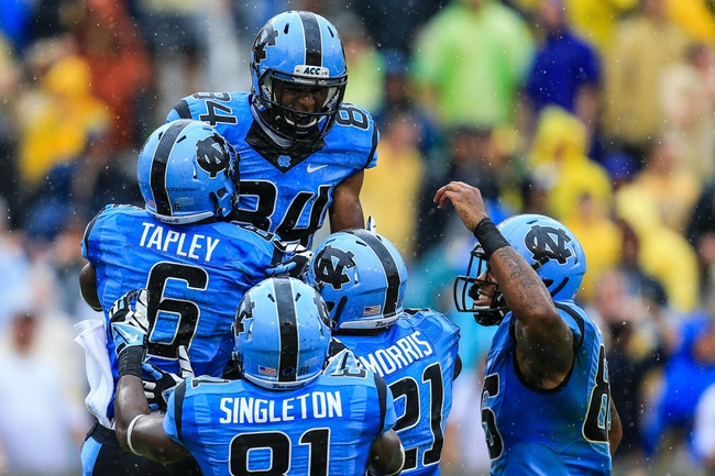 Sep 21, 2013; Atlanta, GA, USA; North Carolina Tar Heels wide receiver Sean Tapley (6) celebrates a touchdown with wide receiver Bug Howard (84) in the first half against the Georgia Tech Yellow Jackets at Bobby Dodd Stadium. Mandatory Credit: Daniel Shirey-USA TODAY Sports