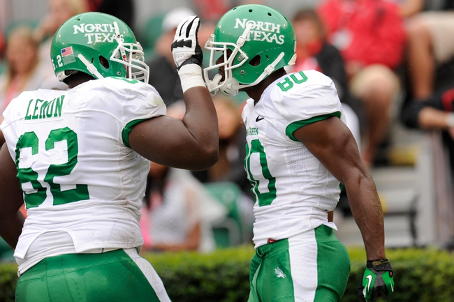 Sep 21, 2013; Athens, GA, USA; North Texas Mean Green wide receiver Darnell Smith (80) reacts with offensive linesman Cyril Lemon (62) after scoring a touchdown against the Georgia Bulldogs during the second quarter at Sanford Stadium. Mandatory Credit: Dale Zanine-USA TODAY Sports
