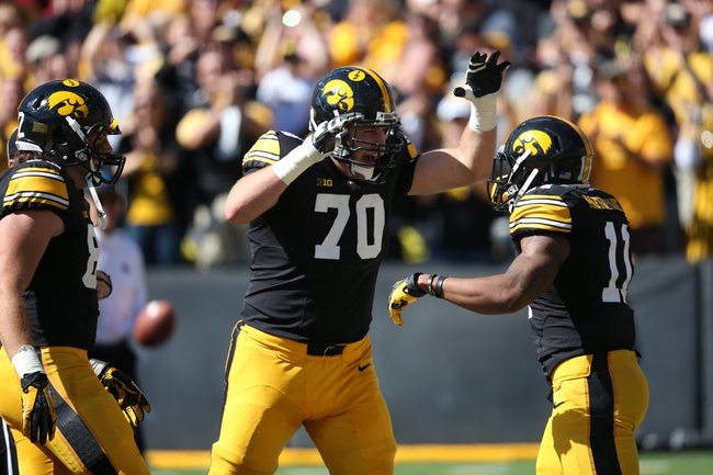 Sep 21, 2013; Iowa City, IA, USA; USA Iowa Hawkeyes tackle Brett Van Sloten (70) celebrates with wide receiver K. martin-Manley (11) after he returns in second punt for a touchdown in the first half against the Western Michigan Broncos at Kinnick Stadium. Mandatory Credit: Reese Strickland-USA TODAY Sports