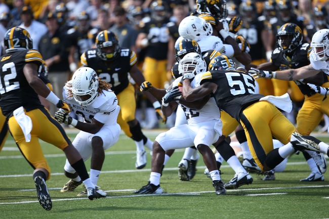 Sep 21, 2013; Iowa City, IA, USA; USA Iowa Hawkeyes linebacker Marcus Collins (55) tackles the Western Michigan Broncos running back Dareyon Chance (22) during the second quarter at Kinnick Stadium. Mandatory Credit: Reese Strickland-USA TODAY Sports