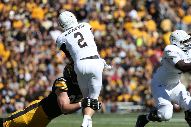 Sep 21, 2013; Iowa City, IA, USA; USA Iowa Hawkeyes D-End Dominic Alvis (79) sacks the Western Michigan Broncos quarterback Tyler Van Tubbergen (2) during the first quarter at Kinnick Stadium. Mandatory Credit: Reese Strickland-USA TODAY Sports