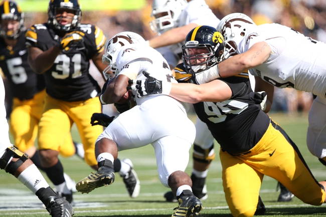 Sep 21, 2013; Iowa City, IA, USA; USA Iowa Hawkeyes tackle Louis Trinca-Pasat (90) tackles the Western Michigan Broncos running back Brian Fields ( 20) during the first quarter at Kinnick Stadium. Mandatory Credit: Reese Strickland-USA TODAY Sports