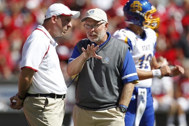 Sep 21, 2013; Lincoln, NE, USA; Nebraska Cornhuskers head coach Bo Pelini and South Dakota State Jackrabbits head coach Jon Stiegelmeier talk prior to their game at Memorial Stadium. Mandatory Credit: Bruce Thorson-USA TODAY Sports