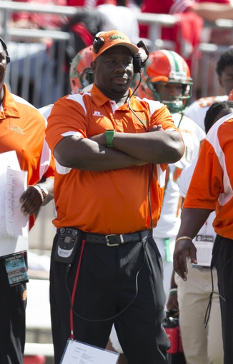 Sep 21, 2013; Columbus, OH, USA; Florida A&M Rattlers head coach Earl Holmes watches as his team is shut out by the Ohio State Buckeyes at Ohio Stadium. Ohio State won the game 76-0. Mandatory Credit: Greg Bartram-USA TODAY Sports