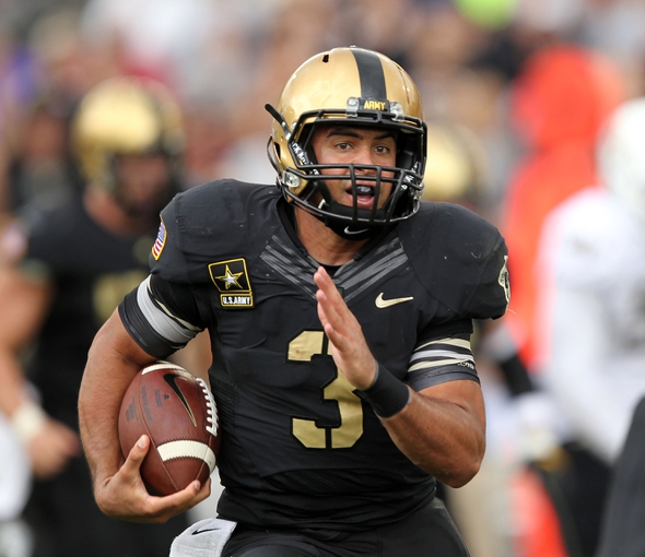 Sep 21, 2013; West Point, NY, USA; Army Black Knights quarterback Angel Santiago (3) rushes the ball during the second half at Michie Stadium. Mandatory Credit: Danny Wild-USA TODAY Sports