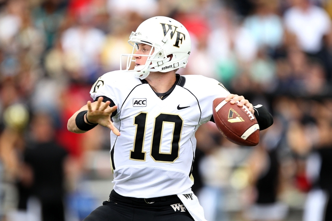 Sep 21, 2013; West Point, NY, USA;  Wake Forest Demon Deacons quarterback Tanner Price (10) passes the ball during the second half at Michie Stadium. Mandatory Credit: Danny Wild-USA TODAY Sports