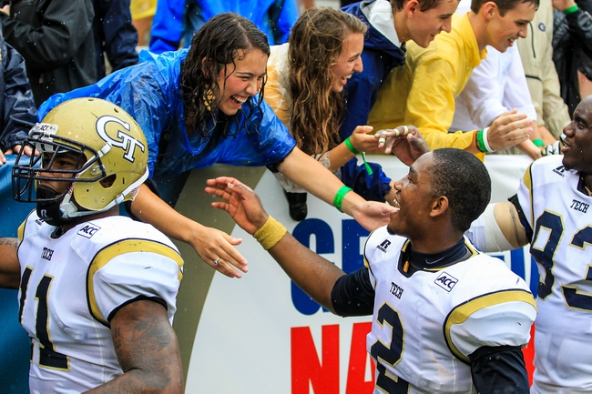 Sep 21, 2013; Atlanta, GA, USA; Georgia Tech Yellow Jackets quarterback Vad Lee (2) celebrates with fans in the stands after beating the North Carolina Tar Heels at Bobby Dodd Stadium. Georgia Tech won 28-20. Mandatory Credit: Daniel Shirey-USA TODAY Sports