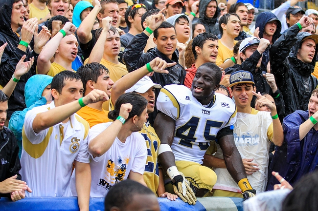 Sep 21, 2013; Atlanta, GA, USA; Georgia Tech Yellow Jackets defensive end Jeremiah Attaochu (45) celebrates the win against the North Carolina Tar Heels with fans at Bobby Dodd Stadium. Georgia Tech won 28-20. Mandatory Credit: Daniel Shirey-USA TODAY Sports