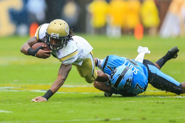 Sep 21, 2013; Atlanta, GA, USA; Georgia Tech Yellow Jackets running back B.J. Bostic (7) is tackled by North Carolina Tar Heels cornerback Tim Scott (7) in the second half at Bobby Dodd Stadium. Georgia Tech won 28-20. Mandatory Credit: Daniel Shirey-USA TODAY Sports