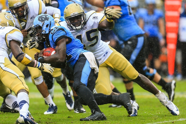 Sep 21, 2013; Atlanta, GA, USA; Georgia Tech Yellow Jackets defensive end Jeremiah Attaochu (45) tackles North Carolina Tar Heels running back Romar Morris (21) on a run in the second half at Bobby Dodd Stadium. Georgia Tech won 28-20. Mandatory Credit: Daniel Shirey-USA TODAY Sports