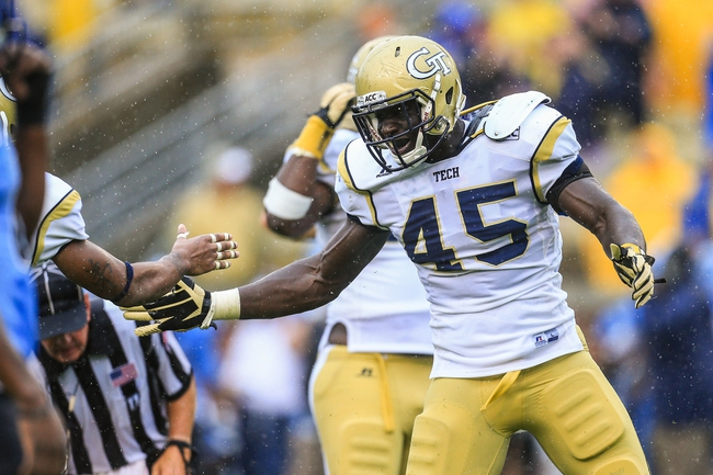 Sep 21, 2013; Atlanta, GA, USA; Georgia Tech Yellow Jackets defensive end Jeremiah Attaochu (45) celebrates a tackle for a loss in the second half against the North Carolina Tar Heels at Bobby Dodd Stadium. Georgia Tech won 28-20. Mandatory Credit: Daniel Shirey-USA TODAY Sports