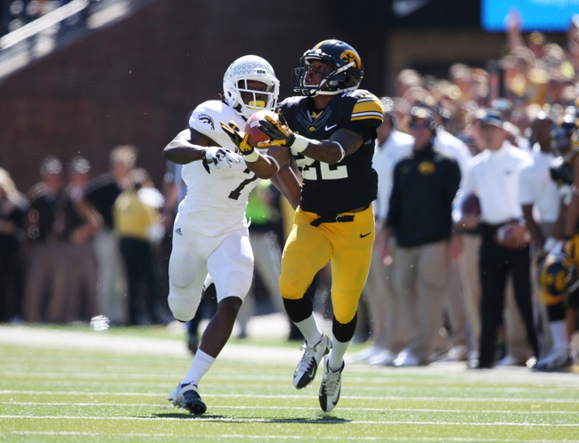 Sep 21, 2013; Iowa City, IA, USA; Iowa Hawkeyes wide receiver Damond Powell (22) catches a pass against cornerback Ronald Zamort (7) of the Western Michigan Broncos during the second half at Kinnick Stadium. Iowa beat Western Michigan 59-3. Mandatory Credit: Reese Strickland-USA TODAY Sports