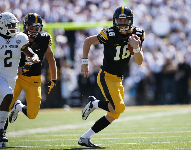 Sep 21, 2013; Iowa City, IA, USA; Iowa Hawkeyes quarterback C.J. Beathard (16) runs for the first down  against the Western Michigan Broncos during the second half at Kinnick Stadium. Iowa beat Western Michigan 59-3. Mandatory Credit: Reese Strickland-USA TODAY Sports
