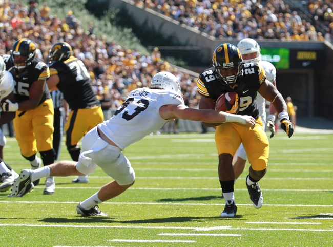 Sep 21, 2013; Iowa City, IA, USA; Iowa Hawkeyes running back LeShun Daniels (29) is pursued by safety Justin Currie (33) of the Western Michigan Broncos during the second half at Kinnick Stadium. Iowa beat Western Michigan 59-3. Mandatory Credit: Reese Strickland-USA TODAY Sports