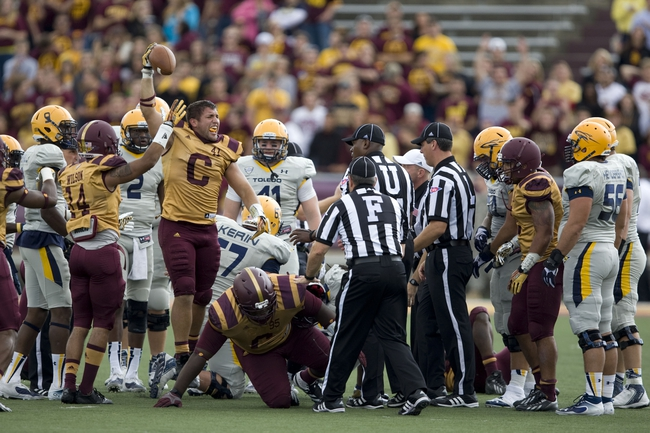 Sep 21, 2013; Mount Pleasant, MI, USA; Central Michigan Chippewas linebacker Justin Cherocci (41) recovers a fumble against the Toledo Rockets during the third quarter at Kelly/Shorts Stadium. Rockets beat the Chippewas 38-17. Mandatory Credit: Raj Mehta-USA TODAY Sports
