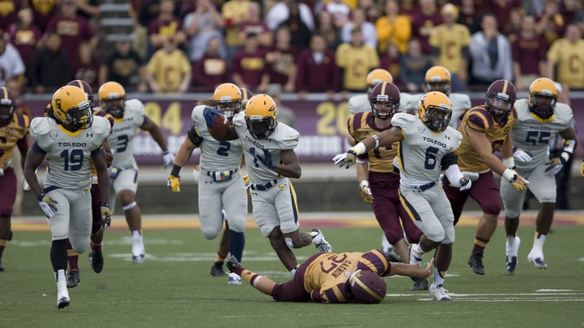 Sep 21, 2013; Mount Pleasant, MI, USA; Toledo Rockets wide receiver Bernard Reedy (1) jumps over Central Michigan Chippewas kicker Connor Gagnon (37) during the third quarter at Kelly/Shorts Stadium. Rockets beat the Chippewas 38-17. Mandatory Credit: Raj Mehta-USA TODAY Sports