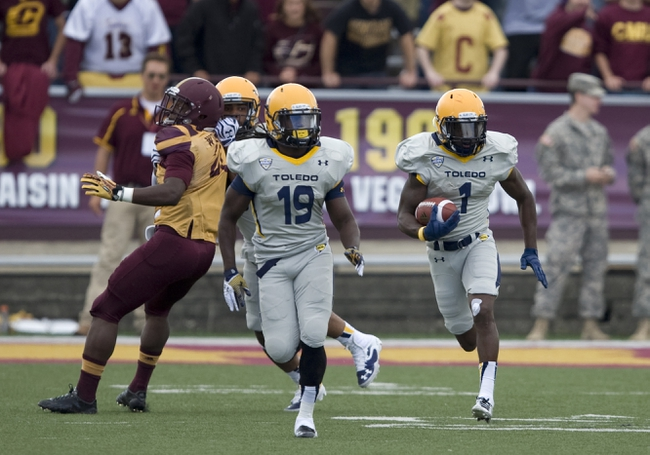 Sep 21, 2013; Mount Pleasant, MI, USA; Toledo Rockets wide receiver Bernard Reedy (1) runs the ball down the field against the Central Michigan Chippewas during the third quarter at Kelly/Shorts Stadium. Rockets beat the Chippewas 38-17. Mandatory Credit: Raj Mehta-USA TODAY Sports