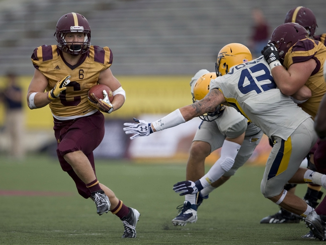 Sep 21, 2013; Mount Pleasant, MI, USA; Central Michigan Chippewas running back Saylor Lavallii (6) runs the ball past Toledo Rockets linebacker Trent Voss (43) during the third quarter at Kelly/Shorts Stadium. Rockets beat the Chippewas 38-17. Mandatory Credit: Raj Mehta-USA TODAY Sports