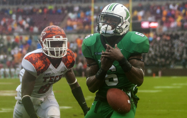 Sep 21, 2013; Blacksburg, VA, USA; Marshall Thundering Herd wide receiver Davonte Allen (6) can not catch a touchdown pass on the final play of the game against Virginia Tech Hokies safety Detrick Bonner (8) at Lane Stadium. Mandatory Credit: Peter Casey-USA TODAY Sports