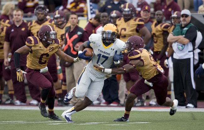 Sep 21, 2013; Mount Pleasant, MI, USA; Toledo Rockets wide receiver Dwight Macon (17) runs after a catch against the Central Michigan Chippewas during the third quarter at Kelly/Shorts Stadium. Rockets beat the Chippewas 38-17. Mandatory Credit: Raj Mehta-USA TODAY Sports