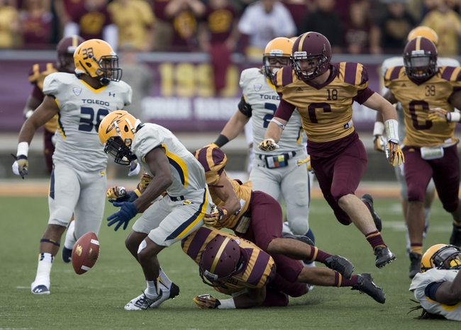 Sep 21, 2013; Mount Pleasant, MI, USA; Toledo Rockets wide receiver Bernard Reedy (1) fumbles the ball against the Central Michigan Chippewas during the third quarter at Kelly/Shorts Stadium. Rockets beat the Chippewas 38-17. Mandatory Credit: Raj Mehta-USA TODAY Sports