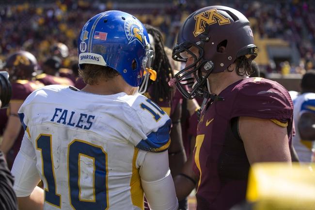 Sep 21, 2013; Minneapolis, MN, USA; San Jose State Spartans quarterback David Fales (10) and Minnesota Golden Gophers quarterback Mitch Leidner (7) talk after the game at TCF Bank Stadium. The Gophers won 43-24. Mandatory Credit: Jesse Johnson-USA TODAY Sports