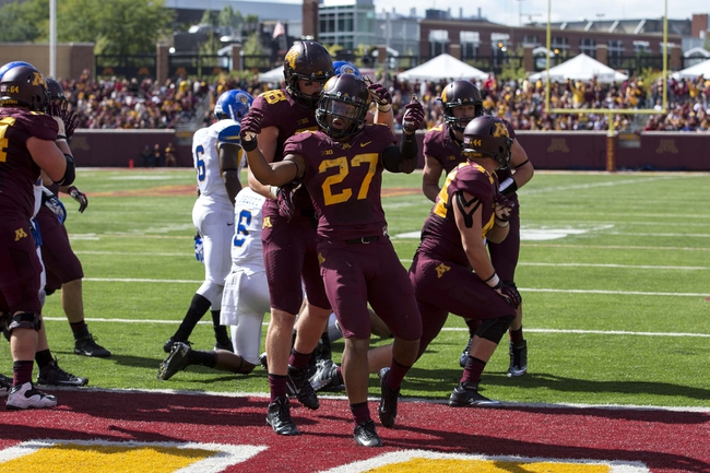 Sep 21, 2013; Minneapolis, MN, USA; Minnesota Golden Gophers running back David Cobb (27) celebrates with Minnesota Golden Gophers tight end Maxx Williams (88) after scoring a touchdown in the second half against the San Jose State Spartans at TCF Bank Stadium. The Gophers won 43-24. Mandatory Credit: Jesse Johnson-USA TODAY Sports