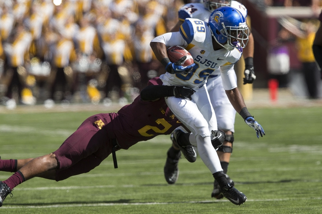 Sep 21, 2013; Minneapolis, MN, USA; Minnesota Golden Gophers defensive back Cedric Thompson (2) attempts to tackle San Jose State Spartans wide receiver Chandler Jones (89) in the second half at TCF Bank Stadium. The Gophers won 43-24. Mandatory Credit: Jesse Johnson-USA TODAY Sports