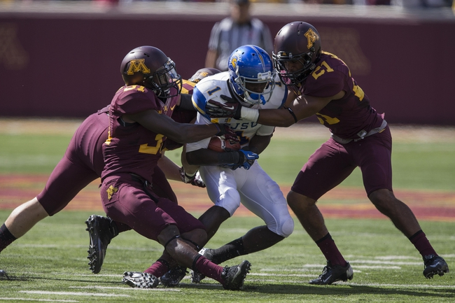 Sep 21, 2013; Minneapolis, MN, USA; San Jose State Spartans wide receiver Jabari Carr (1) gets tackled by Minnesota Golden Gophers defensive back Eric Murray (31) and Minnesota Golden Gophers running back James Gillum (21) after making a catch in the second half at TCF Bank Stadium. The Gophers won 43-24. Mandatory Credit: Jesse Johnson-USA TODAY Sports