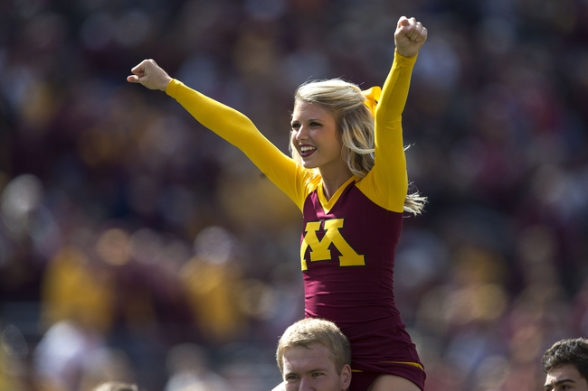 Sep 21, 2013; Minneapolis, MN, USA; Minnesota Golden Gophers cheerleader cheers during the second half against the San Jose State Spartans at TCF Bank Stadium. The Gophers won 43-24. Mandatory Credit: Jesse Johnson-USA TODAY Sports