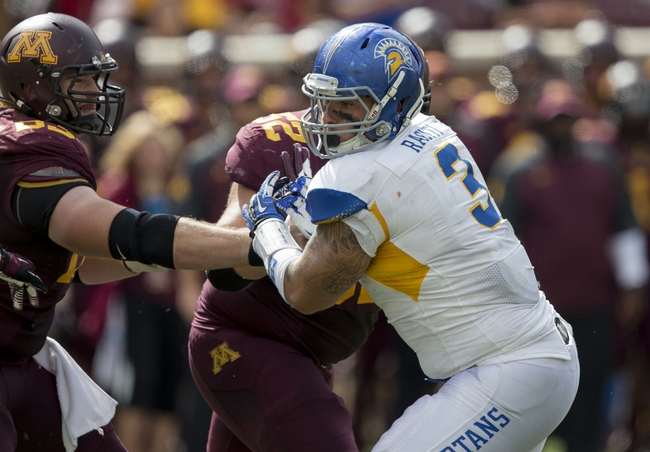 Sep 21, 2013; Minneapolis, MN, USA; San Jose State Spartans defensive tackle Travis Raciti (3) fights off a offensive lineman in the second half against the Minnesota Golden Gophers at TCF Bank Stadium. The Gophers won 43-24. Mandatory Credit: Jesse Johnson-USA TODAY Sports