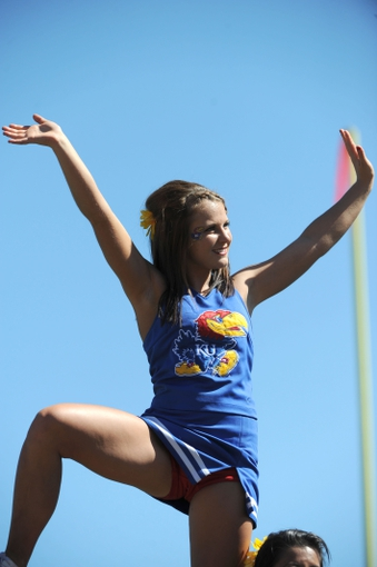 Sep 21, 2013; Lawrence, KS, USA; A Kansas Jayhawks cheerleader performs in the second half against the Louisiana Tech Bulldogs at Memorial Stadium. Kansas won 13-10. Mandatory Credit: John Rieger-USA TODAY Sports
