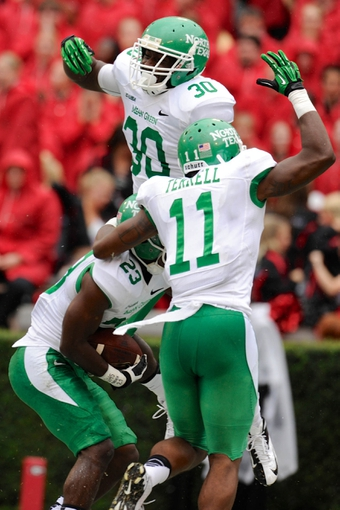 Sep 21, 2013; Athens, GA, USA; North Texas Mean Green defensive back Zac Whitfield (23) reacts to recovering a blocked punt for a touchdown with team mates against the Georgia Bulldogs during the second half at Sanford Stadium. Georgia defeated North Texas 45-21. Mandatory Credit: Dale Zanine-USA TODAY Sports