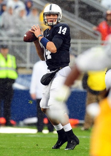 Sep 21, 2013; University Park, PA, USA; Penn State Nittany Lions quarterback Christian Hackenberg (14) drops back to pass in the first quarter against the Kent State Golden Flashes at Beaver Stadium. Mandatory Credit: Evan Habeeb-USA TODAY Sports