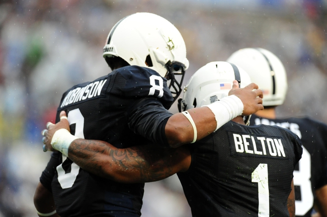 Sep 21, 2013; University Park, PA, USA; Penn State Nittany Lions wide receiver Allen Robinson (8) congratulates running back Bill Belton (1) after scoring a touchdown in the first quarter against the Kent State Golden Flashes at Beaver Stadium. Mandatory Credit: Evan Habeeb-USA TODAY Sports