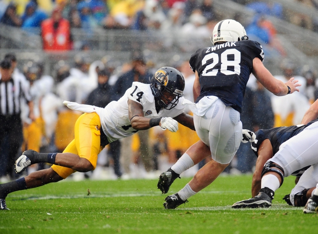 Sep 21, 2013; University Park, PA, USA; Penn State Nittany Lions running back Zach Zwinak (28) is tackled by Kent State Golden Flashes cornerback Dylan Farrington (14) at Beaver Stadium. Mandatory Credit: Evan Habeeb-USA TODAY Sports