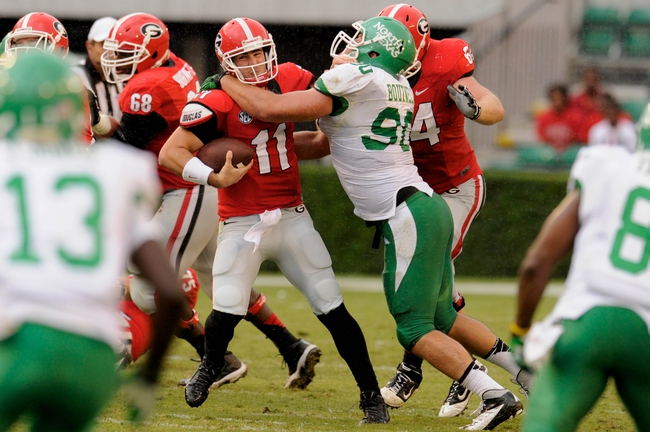 Sep 21, 2013; Athens, GA, USA; Georgia Bulldogs quarterback Aaron Murray (11) is sacked by North Texas Mean Green defensive tackle Ryan Boutwell (90) during the second half at Sanford Stadium. Georgia defeated North Texas 45-21. Mandatory Credit: Dale Zanine-USA TODAY Sports