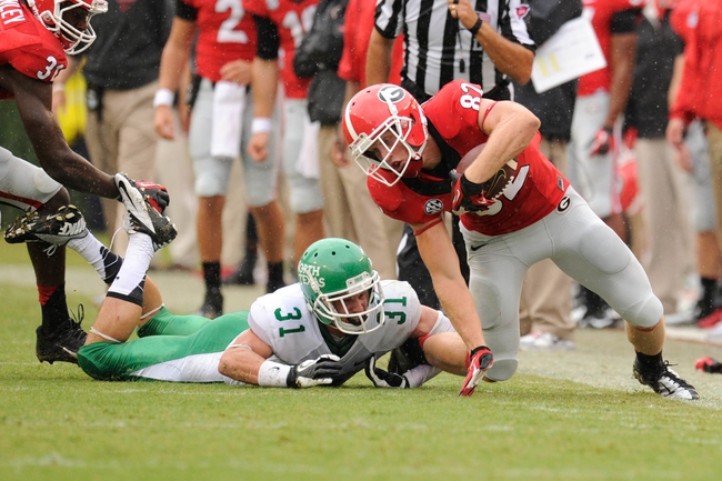 Sep 21, 2013; Athens, GA, USA; Georgia Bulldogs wide receiver Michael Bennett (82) is tackled by North Texas Mean Green defensive back Kenny Buyers (31) during the second half at Sanford Stadium. Georgia defeated North Texas 45-21. Mandatory Credit: Dale Zanine-USA TODAY Sports